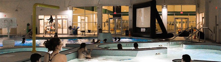 people watching movie in pool