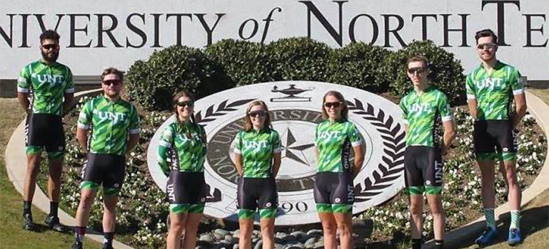 cycling team in uniforms at UNT seal