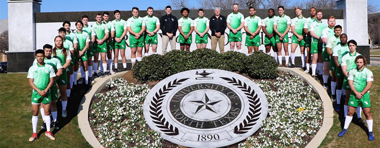 mens rugby team posing at UNT seal